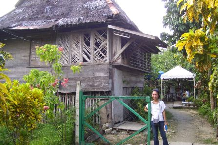Me in front of our old grandparents' house. Traditional bahay kubo made of bamboo and... wood. The house is raised; the bottom part serves as the chicken coop. We slept on the floor in the sala when we were kids, and the chickens would wake me up at ungodly hours because of their crowing lol. The new house is behind this one..