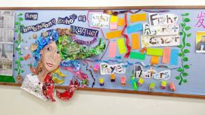 "Grade 3 students recreated ""Ang Pambihirang Buhok ni Raquel"" on their bulletin board using recycled materials for Literacy Month. Photo by Darrel Marco"