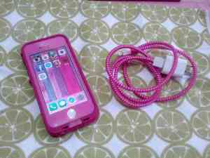 Pink background, Lifeproof case, and cord protector.