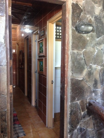 Hallway of bathrooms. There were three indoor toilets and baths (one set was inside the master bedroom), and one outdoor toilet and bath. When I say outdoor it was beside the outdoor cabin and not inside the main house.